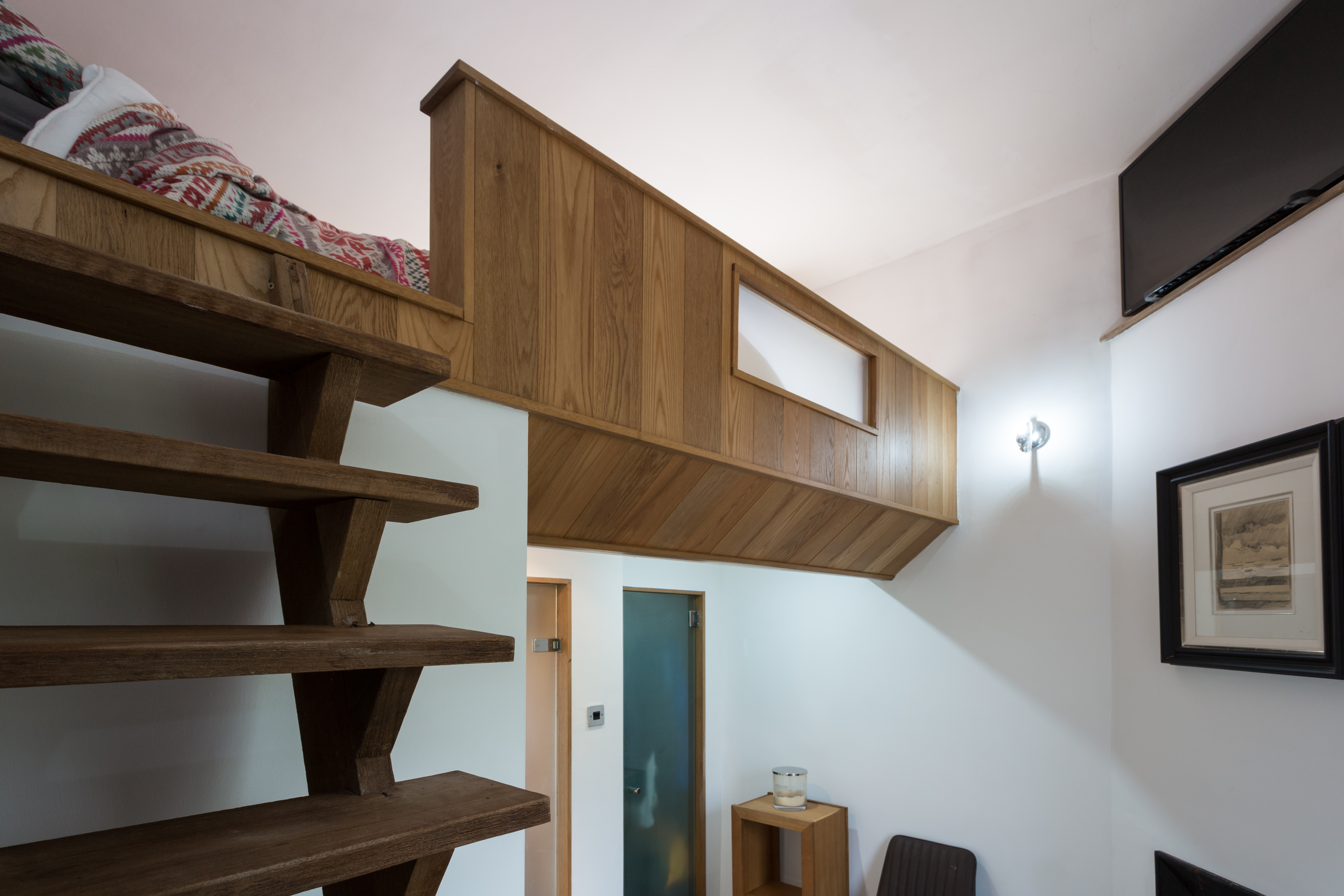 A bed can be seen up the stairs - with the home perfect for a single person or couple