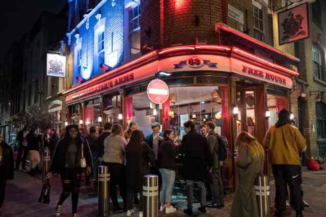 Drinkers gathered outside pubs and bars