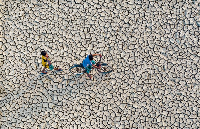 A Thirsty Earth by Abdul Momin, taken in Chittagong, Bangladesh showing the cracking land during an intense drought in the area