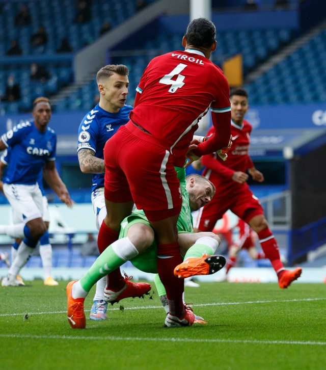 Pickford lunged to try and stop the defender scoring at the back post