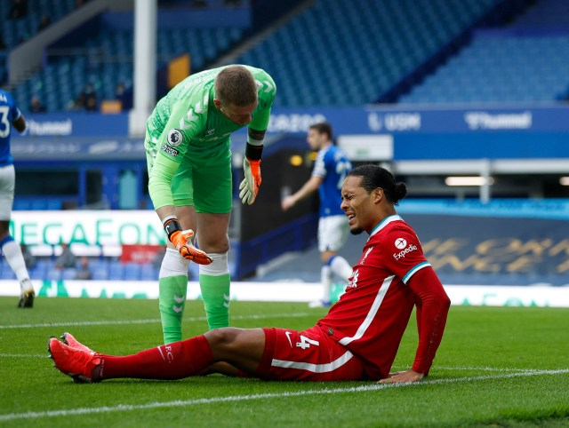 Pickford dived in at the feet of the Liverpool centre-back Van Dijk