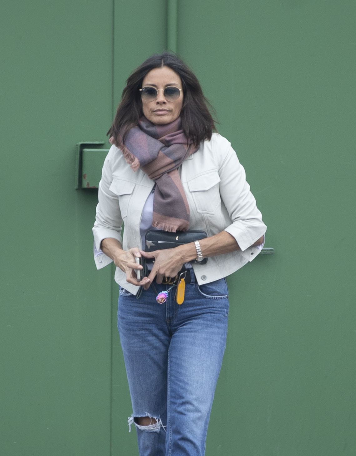 Melanie Sykes, 50, returns to the UK alone after enjoying a six-day fling with a gondolier, 23, in Venice