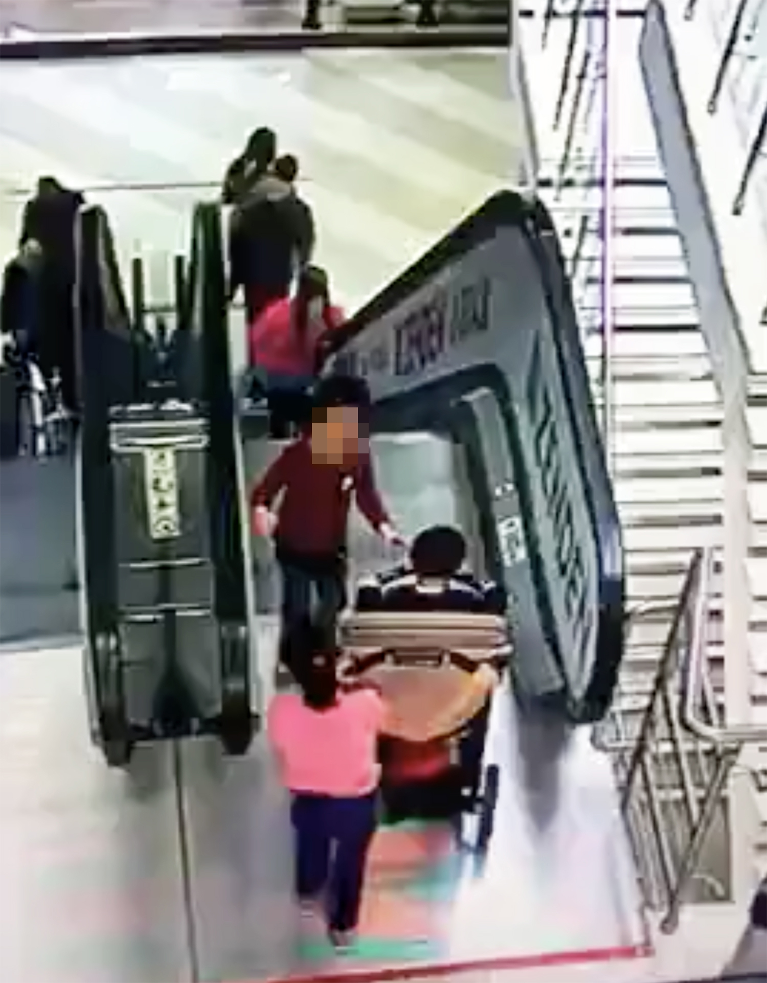 Two kids left with serious head injuries after pushchair somersaults down escalator at shopping centre