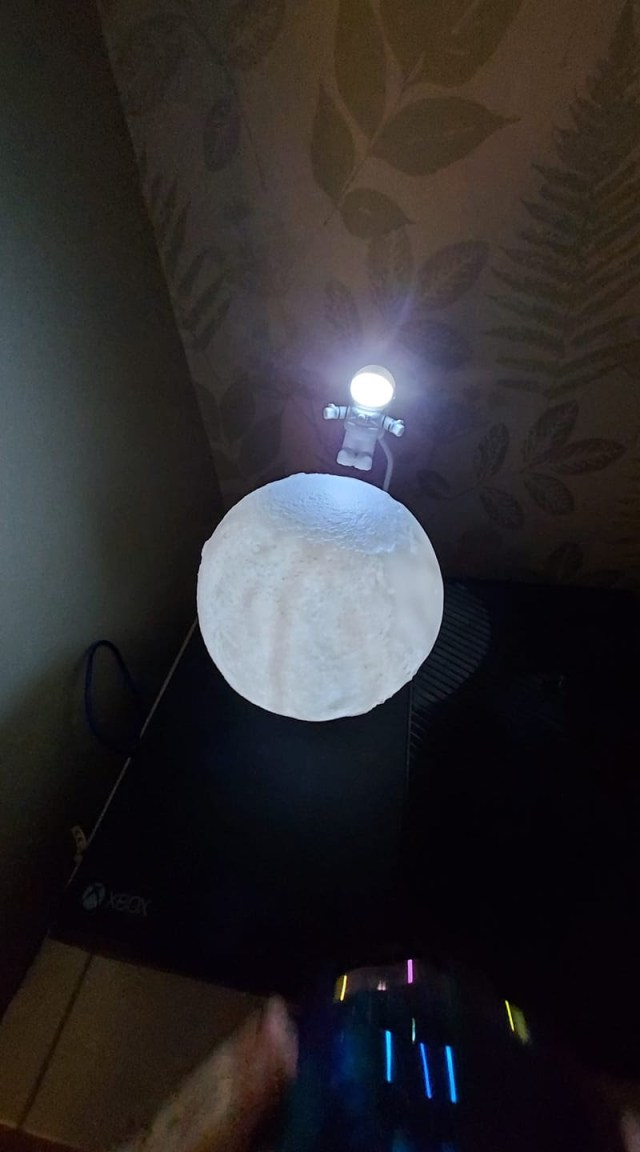 The moon lamp accessorised with a little astronaut