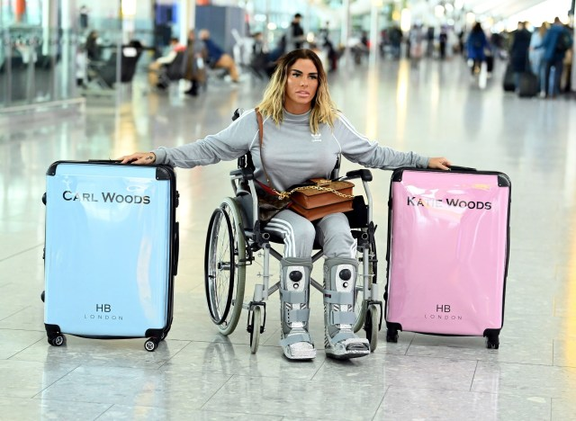 Katie Price fuels rumours she's secretly married Carl by taking his name on her personalised luggage