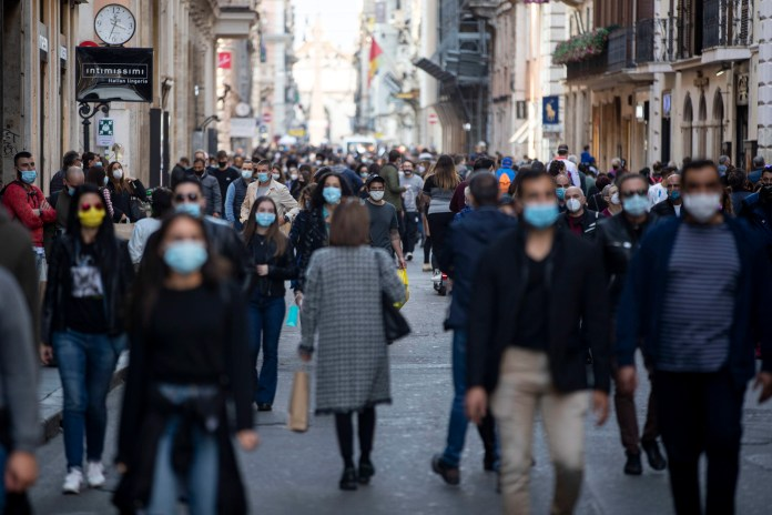 People wearing masks in Rome amid rising infections in the country