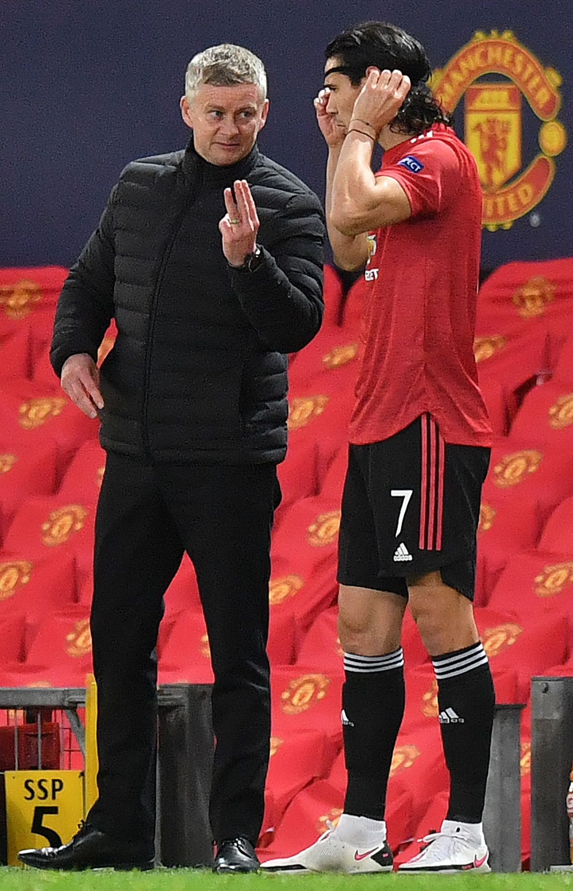 Ole Gunnar Solskjaer hands instructions to Edinson Cavani against RB Leipzig in Wednesday's 5-0 Champions League group win
