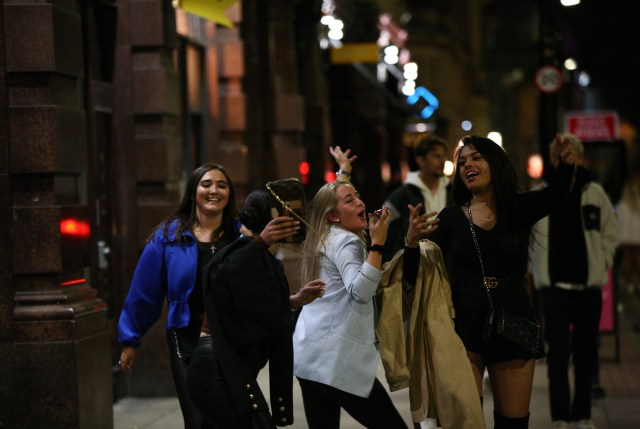Friends in Manchester launched into song as the curfew approached last night