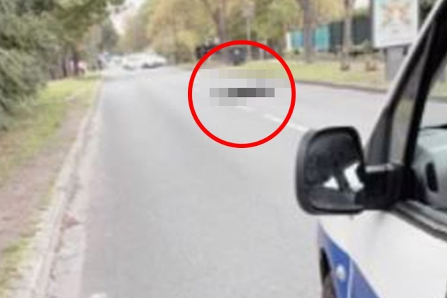A picture of a body lying in the road was shared on Twitter after Frenchanti-terror prosecutors confirmed a man had been decapitated
