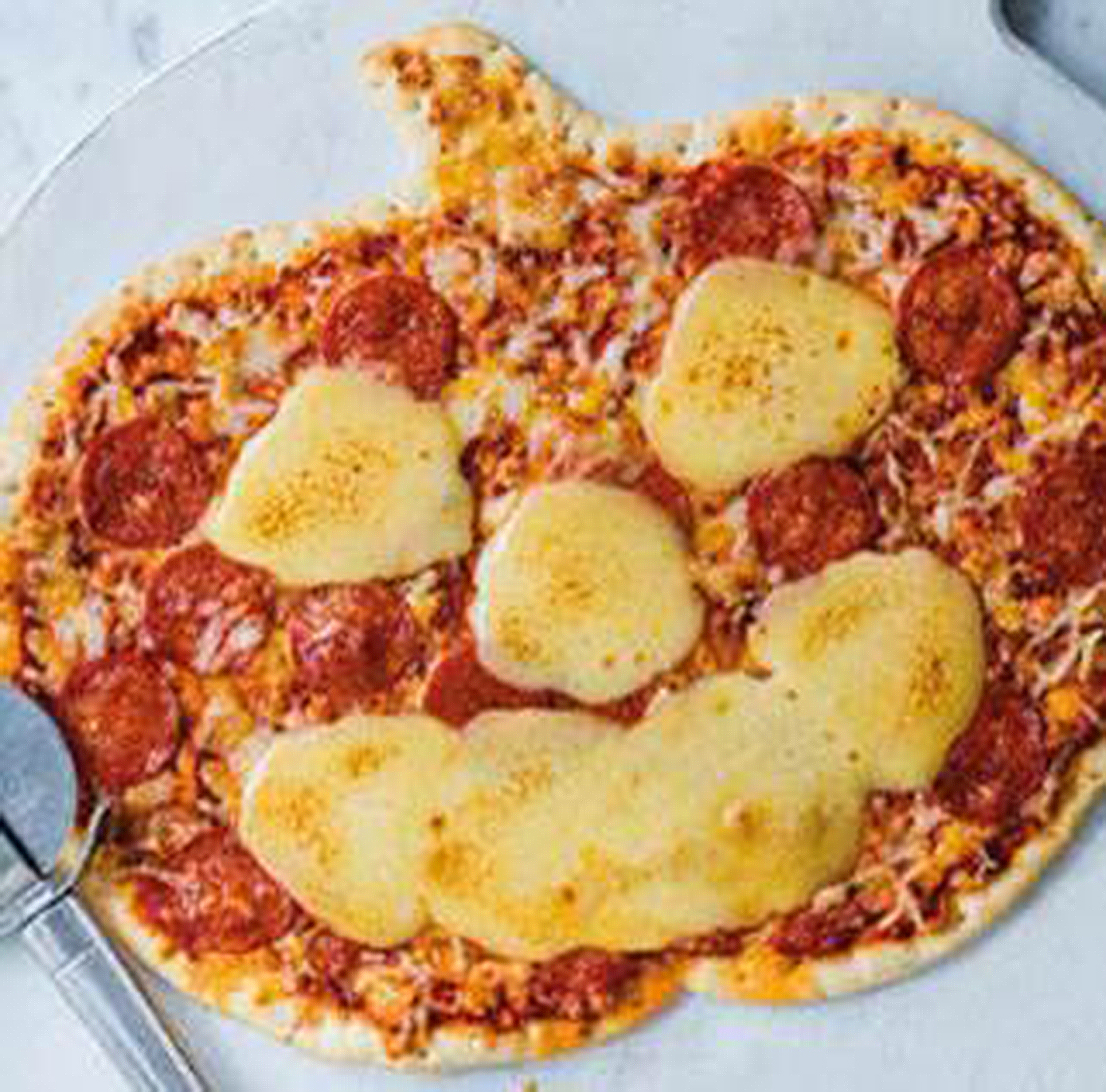 Asda's Halloween pizzas are back and they're shaped like spooky pumpkins