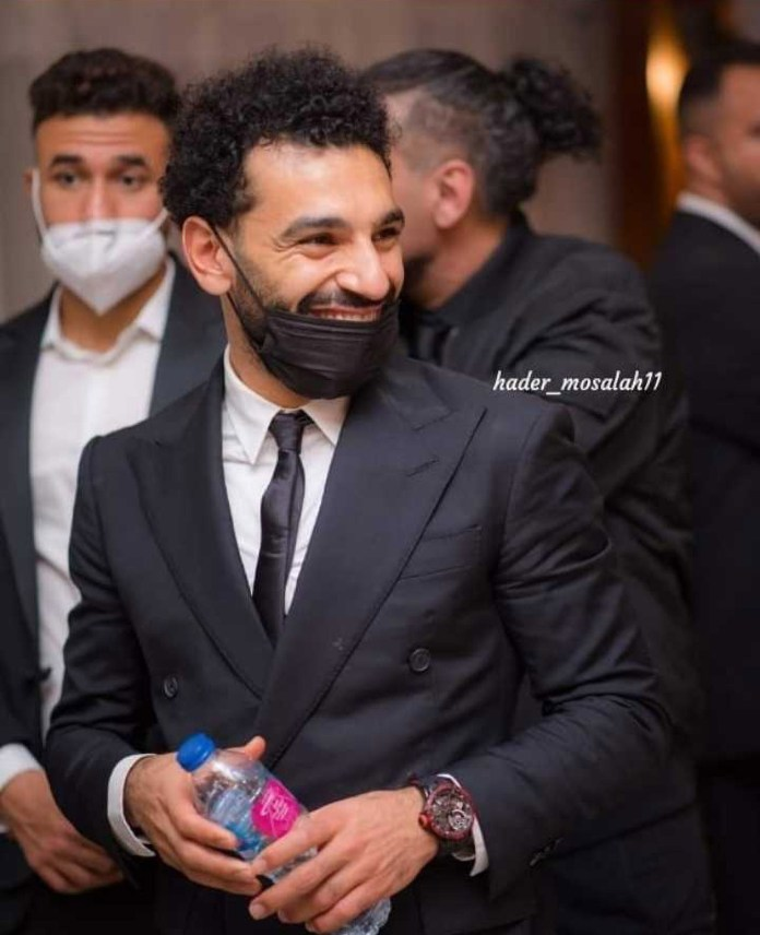 You could see Salah smiling behind a mask