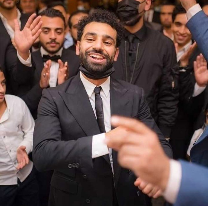 Salah looked good in a fitted black suit and tight black tie