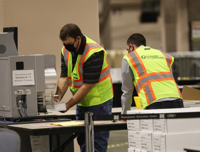 Election officers count the ballots in Philadelphia