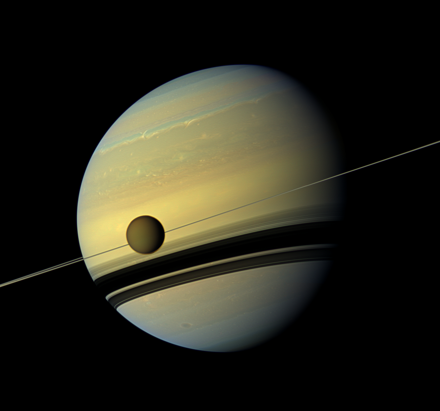View of Saturn and its moon Titan from Nasa's Cassini spacecraft