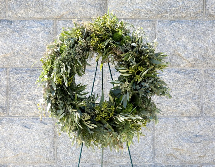 The couple laid an all-green poppyl-free wreath during their visit to the cemetery