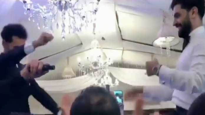 Salah and his brother Nasr danced while being hoisted