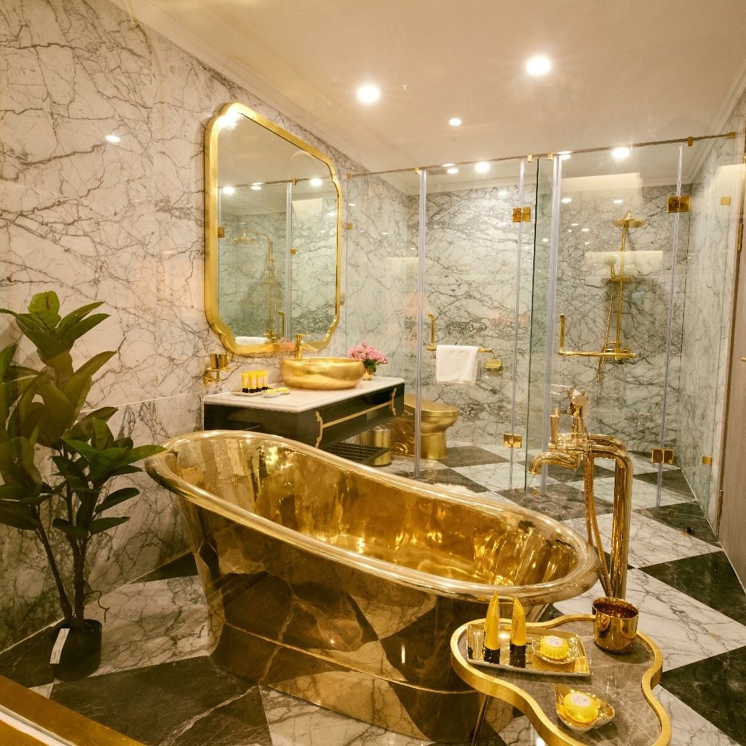 The rooms are complete with gold bathtubs and even a gold TOILET