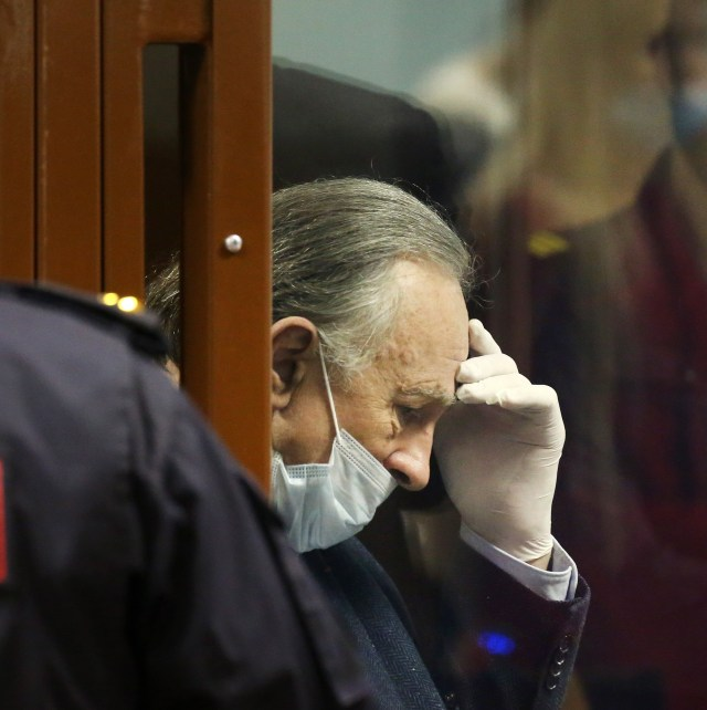 Sokolov holds his head in his hand as he faces the court for murder