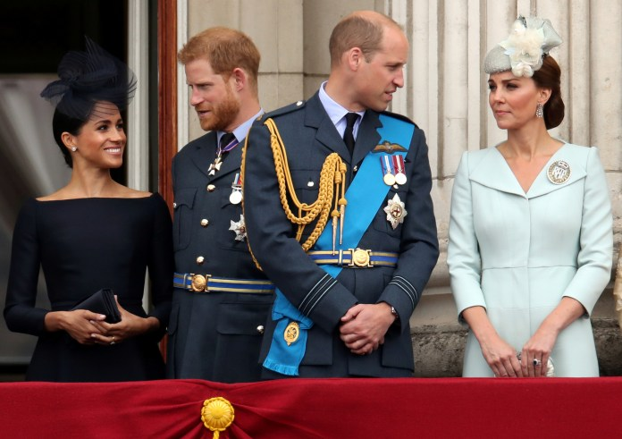 Meghan, Harry, William and Kate stand on the balcony of Buckingham Palace in 2018