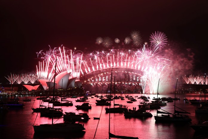 New Year's Eve fireworks erupt over Sydney's iconic Harbour Bridge and Opera House, but no one was allowed to watch them up close