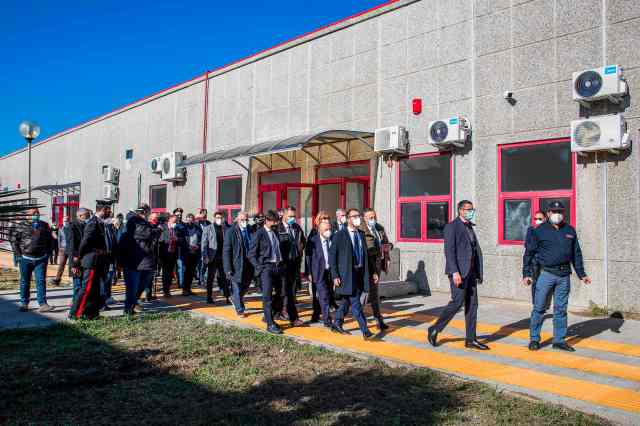 Italy's Minister of Justice Alfonso Bonafede touring the converted call centre with officials, police and reporters