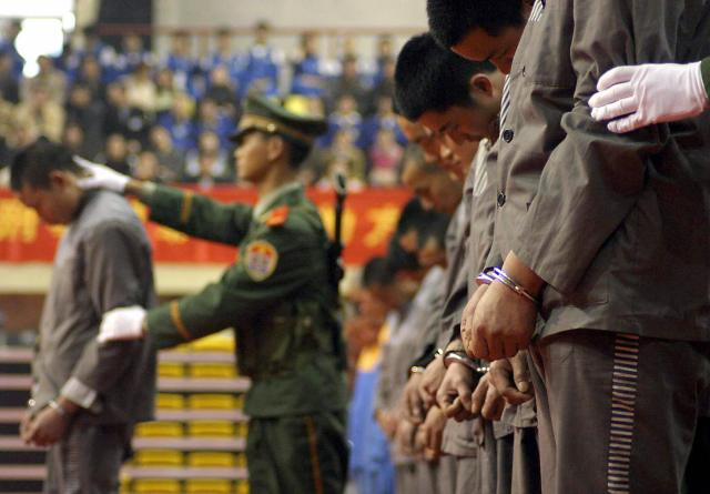 Chinese police show of a group of convicts at a sentencing rally in Wenzhou