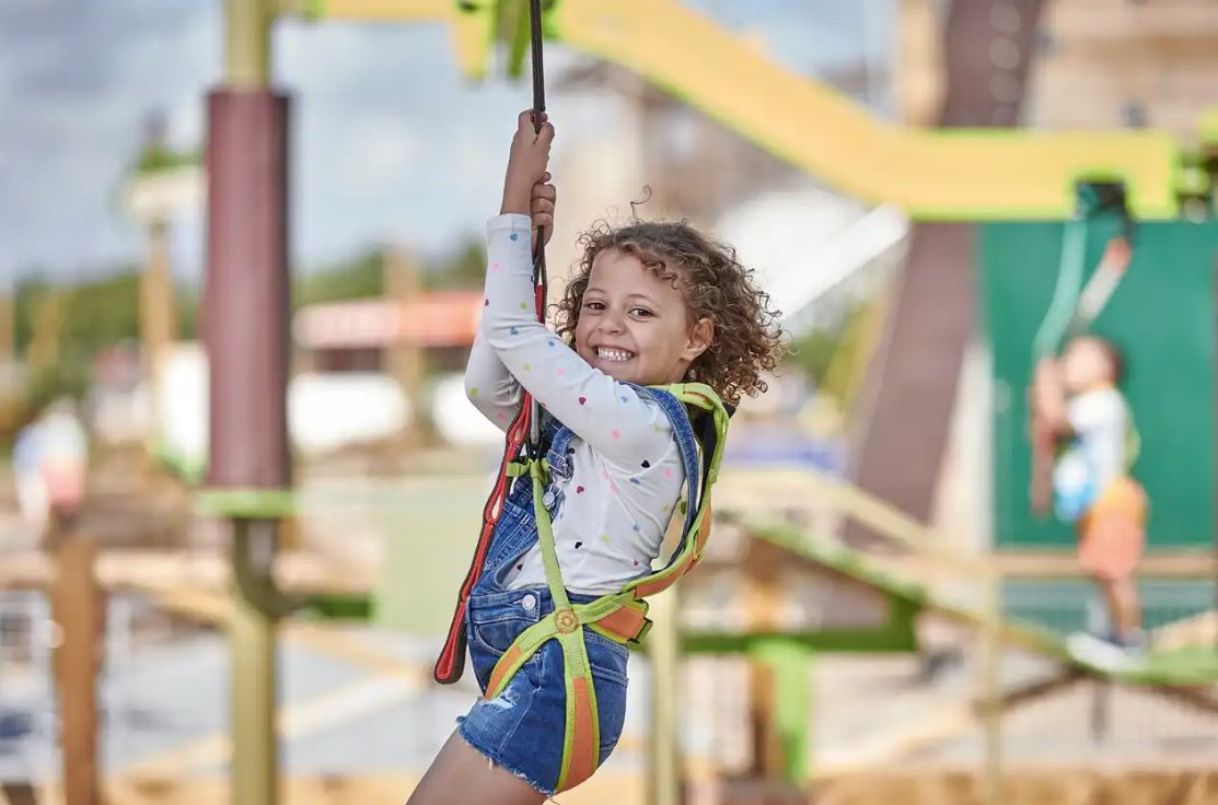 Kids can challenge themselves on an aerial adventure course