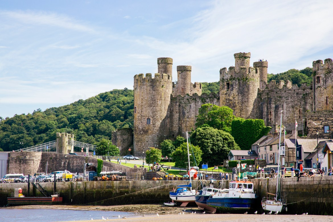 Along the North Wales coastline, you'll fly past Conwy Castle and its pretty harbour