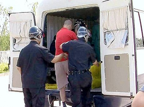 Pictures allegedly showing Chinese officials loading a man into the back of an 'execution van'