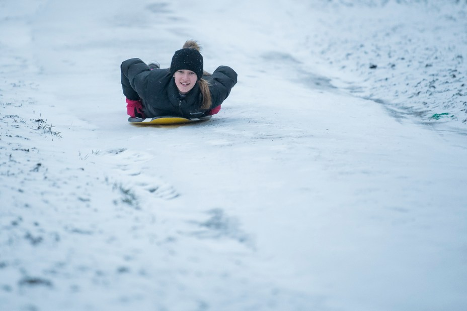 The snow was so heavy in Hampstead Heath this morning that one thrill-seeker took her boogie board out
