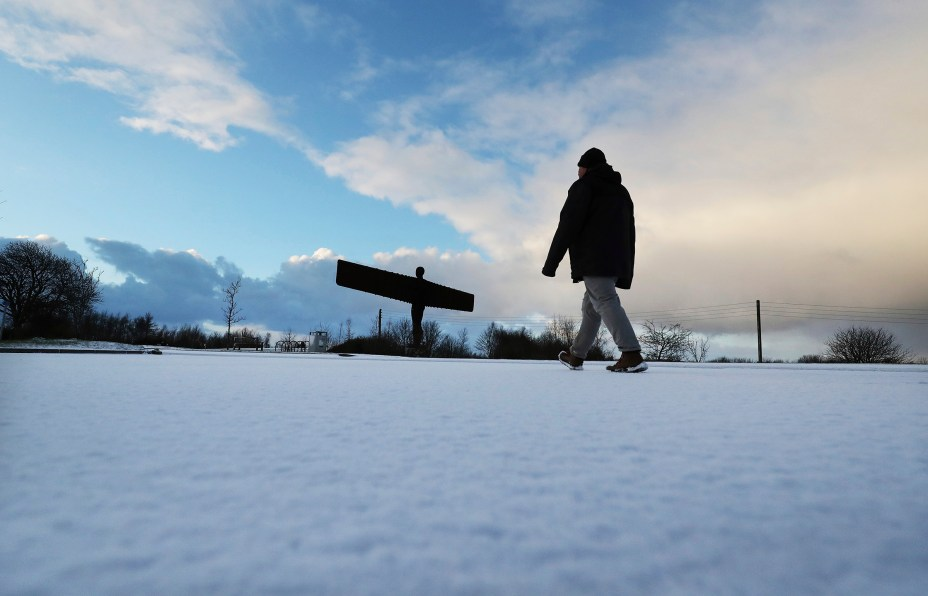 A walker enjoys a view of the Angel of the North in Gateshead
