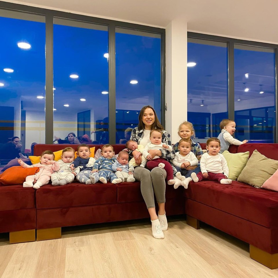 Christina Ozturk, 23, with her football team of babies at home in Batumi, Georgia