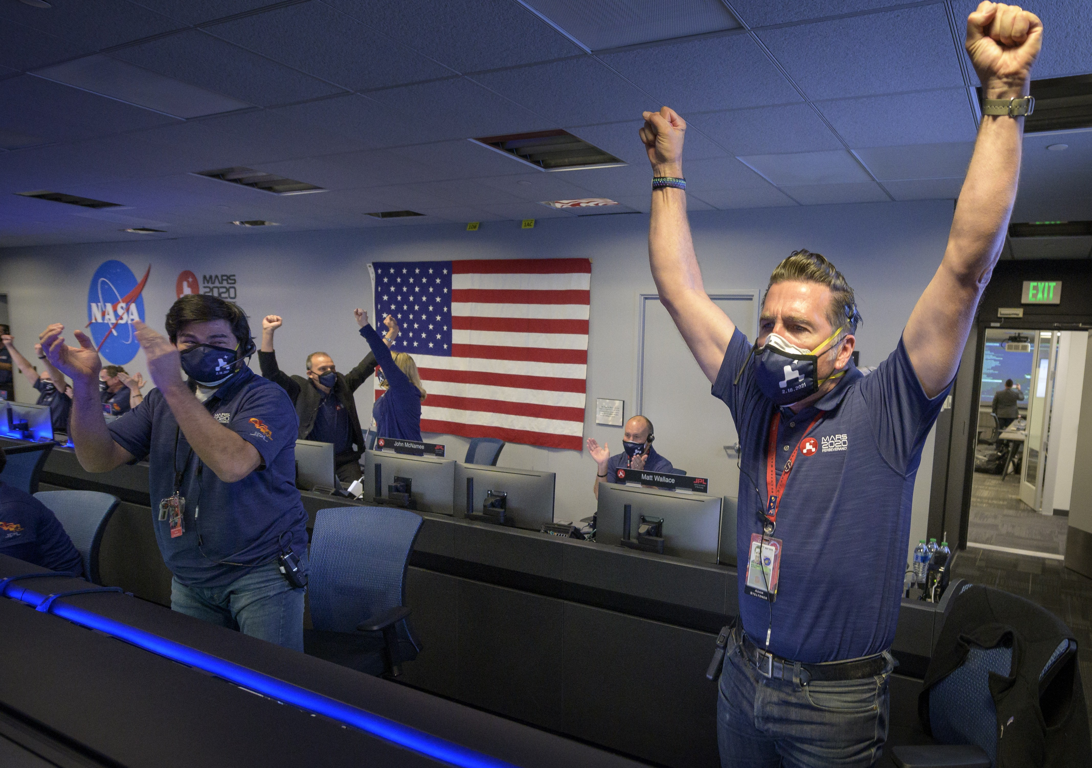 Members of NASA's Perseverance rover team react after receiving confirmation the spacecraft successfully touched down on Mars