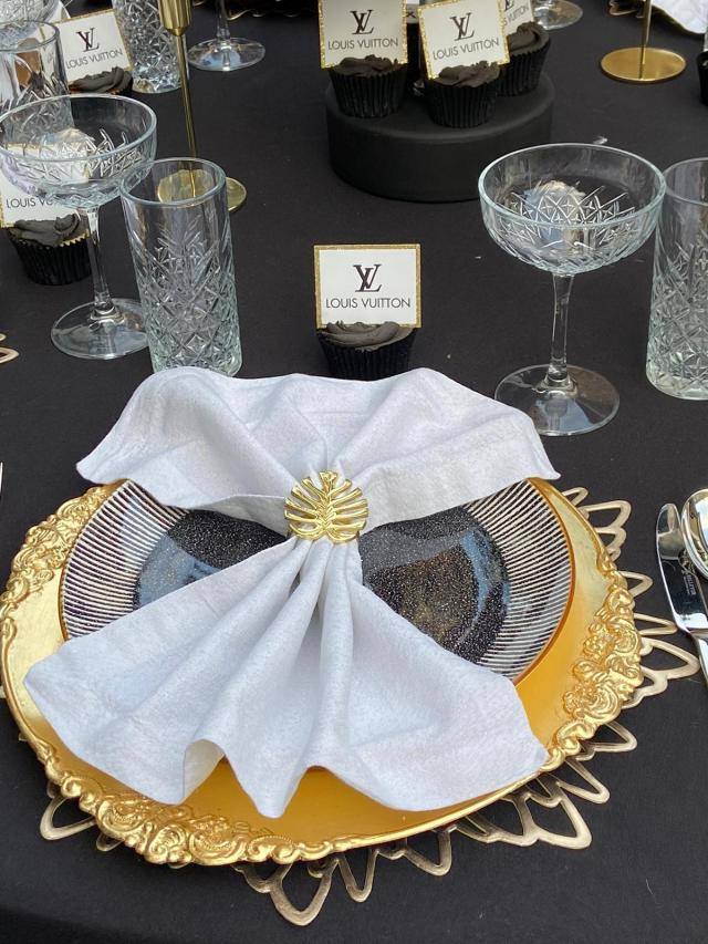 The tableware followed the same gold, black and white colour theme