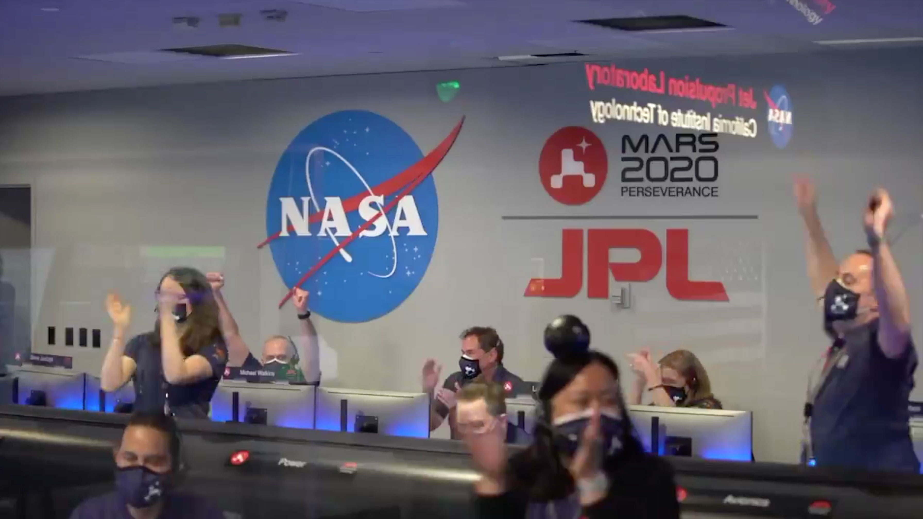 Nasa staff celebrating the safe landing of the £2.4billion robot
