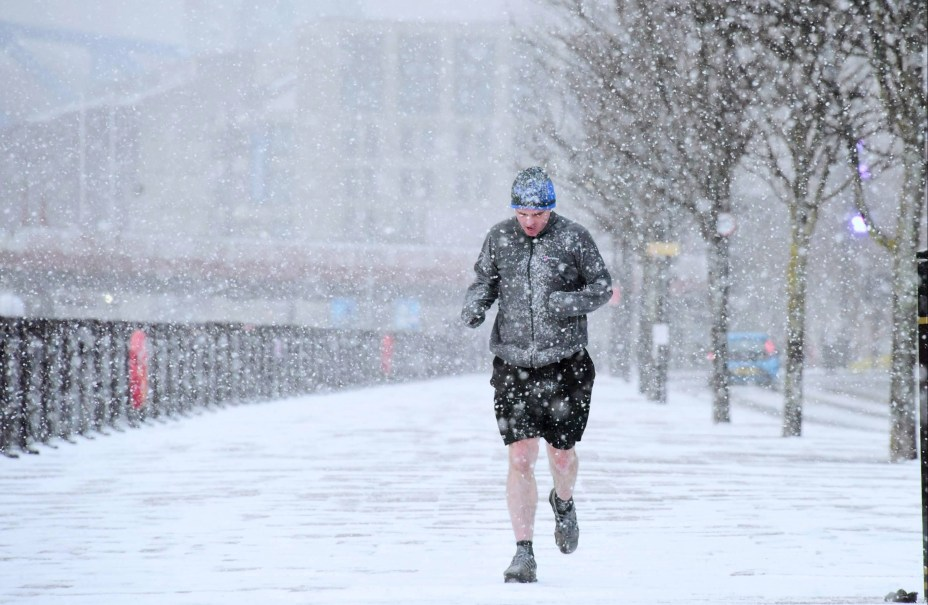 One hardy runner didn't miss the opportunity to jog through a blizzard in Newcastle