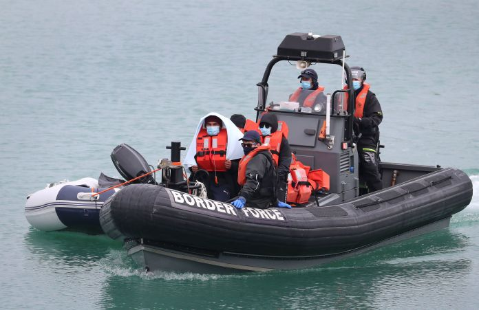 Small boat with illegal immigrants arrives in Dover after being picked up by border forces