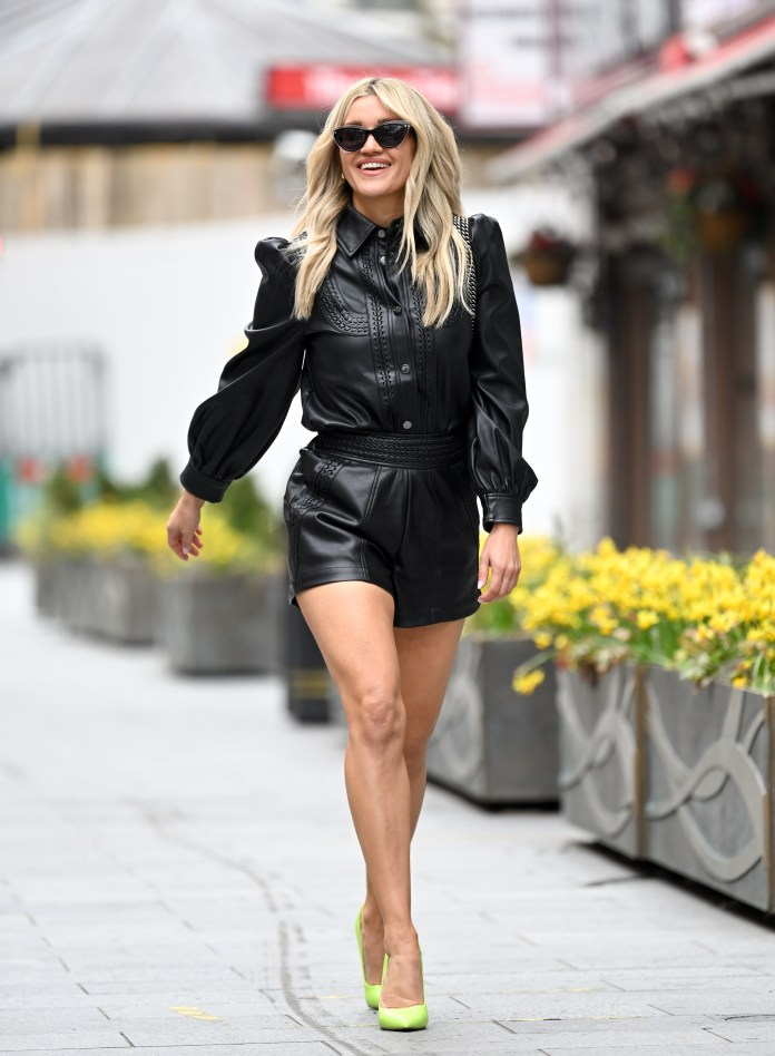 Stylish Ashley is caught on camera with a cheeky grin after her radio show