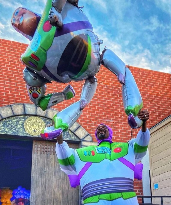 Snoop posted the pictures to Instagram writing 'Grandpa buzz light'