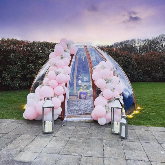 It was decorated with pink and silver balloons