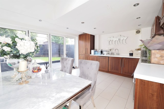 It boasts three bedrooms and an open-plan wood panelled kitchen