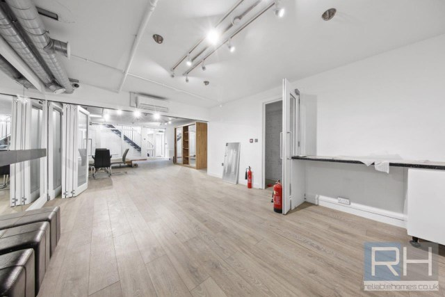 The flat, which boasts 789sq ft of space, has trendy industrial-style finishes with pipes left on display