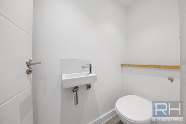 The bathroom also contains a separate toilet