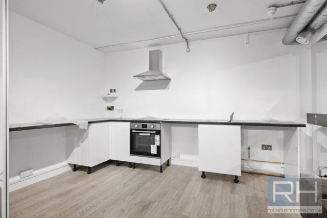The open-plan design sees the reception areas lead to a spacious fitted kitchen