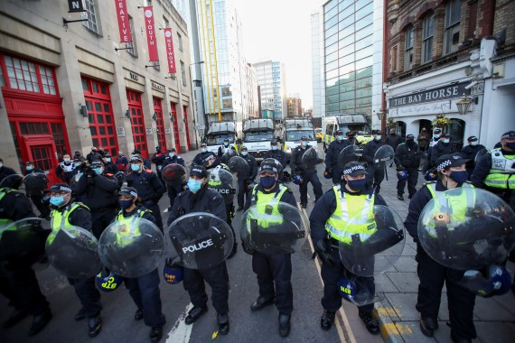 Riot police lined the streets to keep the protest contained