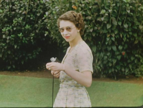 A young Queen holding a camera on Christmas Day in 1953