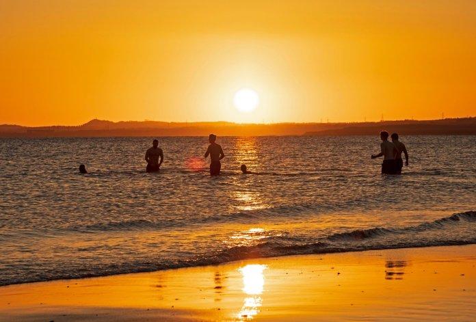 Cold water swimmers take a dip as the sun comes up in Portobello, Edinburgh