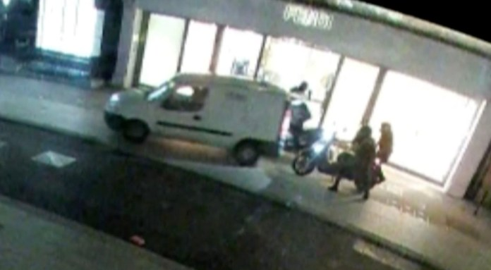 A security guard stops a raid on a London store by reversing his van into the criminals