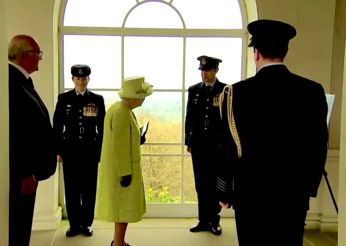 The Queen, seen speaking to RAAF officers, commemorated the 100th year anniversary of the Air Force