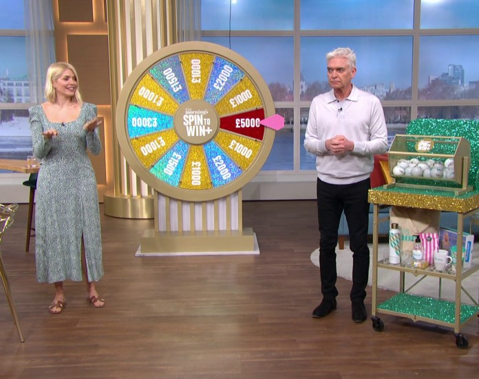 Holly and Phil had to swap places on Spin To Win because Holly couldn't use the tombola